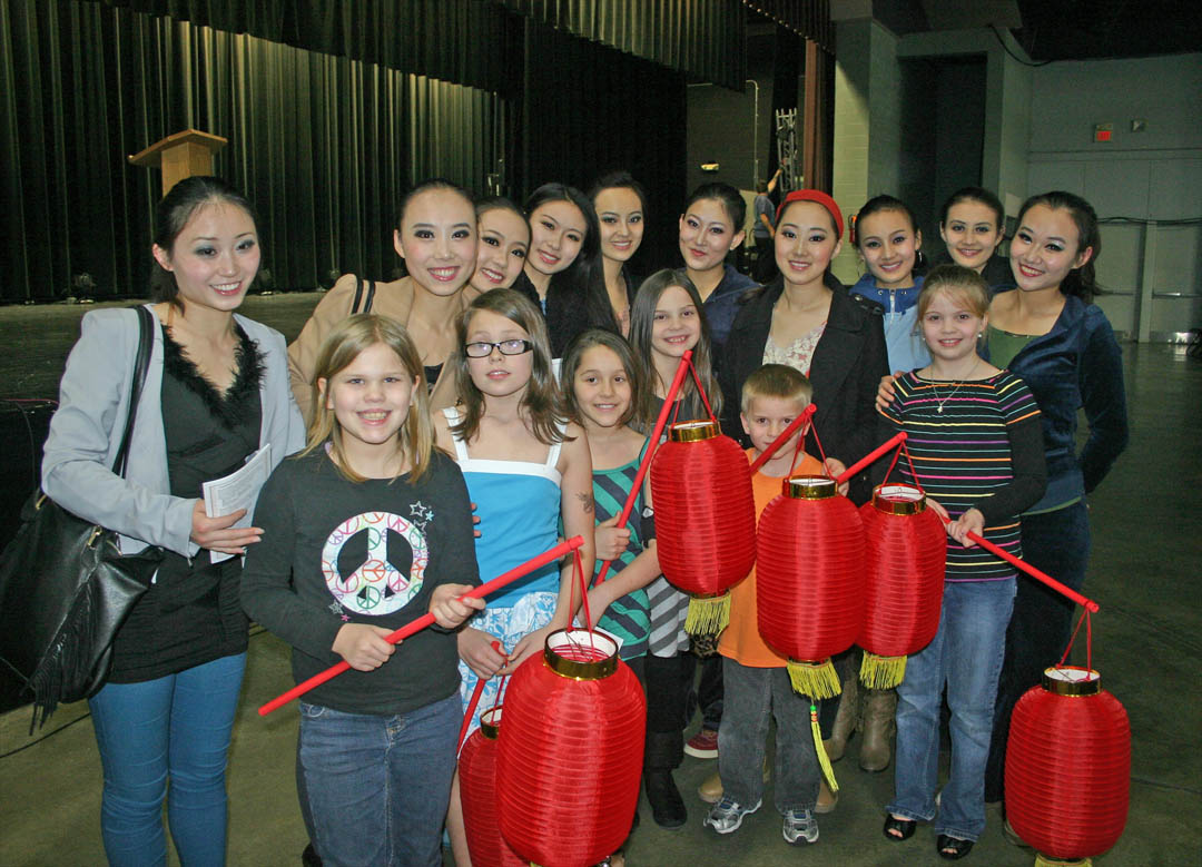 Click to enlarge,  Shanxi University dancers and musicians from the People's Republic of China delighted and thrilled an audience of about 600 with their performance Feb. 1 at the Dennis A. Wicker Civic Center. After the show, members of the dance troupe presented red lanterns used during one of the dances to youngsters with Girl Scout Troop 101 of Buffalo Presbyterian Church. Central Carolina Community College's Confucius Classroom, in partnership with N.C. State University's Confucius Institute, sponsored the performance by professors and students of Shanxi University's School of Music. For more information on CCCC's Confucius Classroom, visit the college's Web site,  www.cccc.edu/confucius  or call (919) 718-7228 or (919) 718-7376.