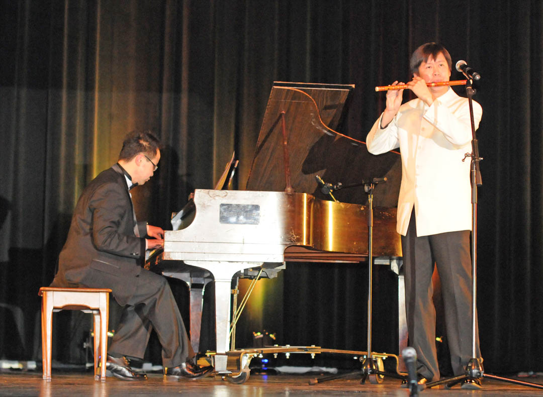 Click to enlarge,  Flutist Xi Xiao and pianist Zhao Yichao perform 'Spring in the Date Garden,' a traditional folk song from Shanxi Province, during the Shanxi University Art Delegation show Feb. 1 at the Dennis A. Wicker Civic Center. The show, which attracted an audience of 600, included instrumental and dance numbers, as well as the creation of a piece of art. Central Carolina Community College's Confucius Classroom, in partnership with N.C. State University's Confucius Institute, sponsored the performance by professors and students of Shanxi University's School of Music. For more information on CCCC's Confucius Classroom, visit the college's Web site,  www.cccc.edu/confucius  or call (919) 718-7228 or (919) 718-7376.
