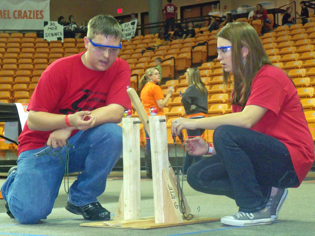 Click to enlarge,  Lee Early College students Riley Gray (left) and Sarah Poe prepare for 'Storm the Castle,' their event at the Feb. 18 Regional Science Olympiad Competition, held at Campbell University. Gray and Poe's trebuchet took third-place in the event, which  required teams to build a device capable of launching a projectile. The whole LEC team placed second overall, earning the right to go on to the North Carolina State Science Olympiad Tournament in April.
