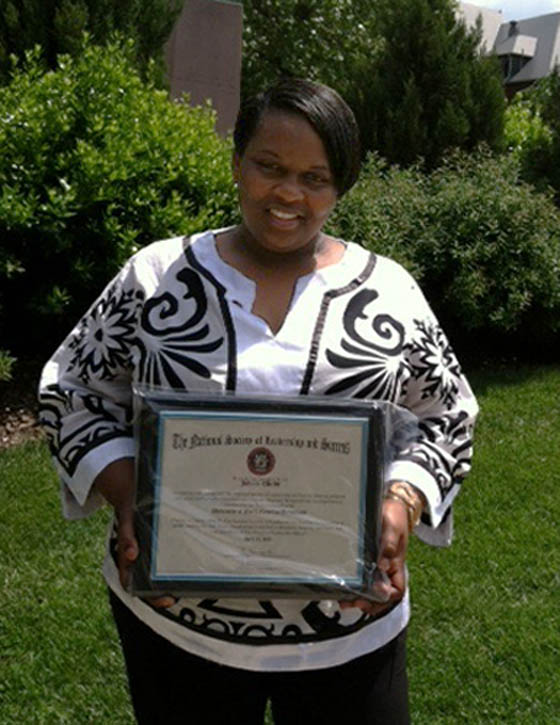 Click to enlarge, Johnita Ellerby, of Sanford, holds her membership certificate following her induction into the National Honor Society of Leadership and Success at UNC-Greensboro. She made a long journey from the darkness of abuse to the light of lifting others. A 2011 graduate of Central Carolina Community College, she is now an honor student at UNCG, earning a degree in Human Services. She plans to earn her doctorate and teach classes on preventing and dealing with child abuse and family violence, as well as lobby for tougher laws against child abusers.