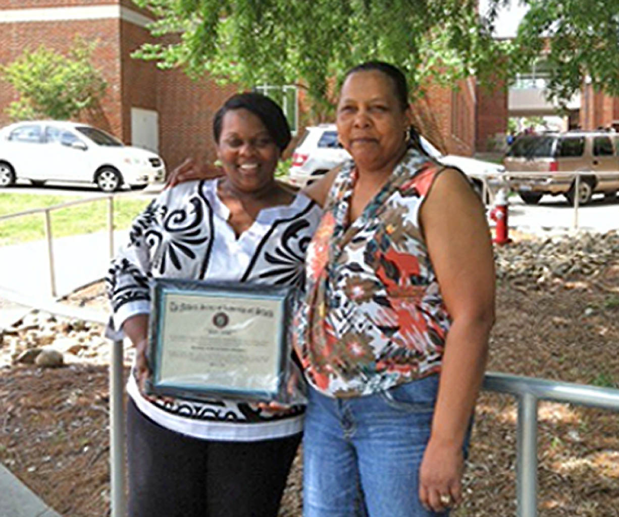 Click to enlarge, Johnita Ellerby (left), of Sanford, holds her membership certificate following her induction into the National Honor Society of Leadership and Success at UNC-Greensboro. With her is her mother, Odessa Ellerby Jackson. Ellerby made a long journey from the darkness of abuse to the light of lifting others. A 2011 graduate of Central Carolina Community College, she is now an honor student at UNCG, earning a degree in Human Services. She plans to earn her doctorate and teach classes on preventing and dealing with child abuse and family violence, as well as lobby for tougher laws against child abusers.