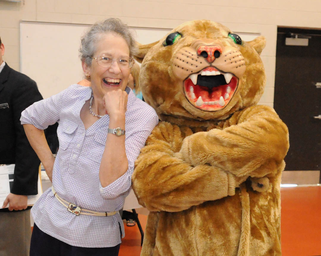 Click to enlarge,  Martha Underwood (left), of Sanford, shares a light moment with Charlee, Central Carolina Community College's mascot. The Lee County Board of Commissioners has appointed her to the college's board of trustees. She will be sworn in for a four-year term at the July 25 trustees meeting.