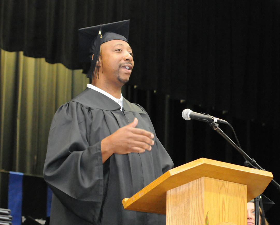 Click to enlarge,  Darel Davis, of Lee County, delivers one of the graduation addresses at Central Carolina Community College's Summer Commencement Exercises Aug. 2 at the Dennis A. Wicker Civic Center. Davis received his Associate in Applied Science in Electronics Engineering Technology and has already gotten a job. About 170 students completed their studies during the summer semester; 100 participated in the exercises. The graduates earned almost 300 degrees, diplomas and certificates. Some will continue their education at four-year institutions, while most will take their new skills and knowledge directly into the workforce.