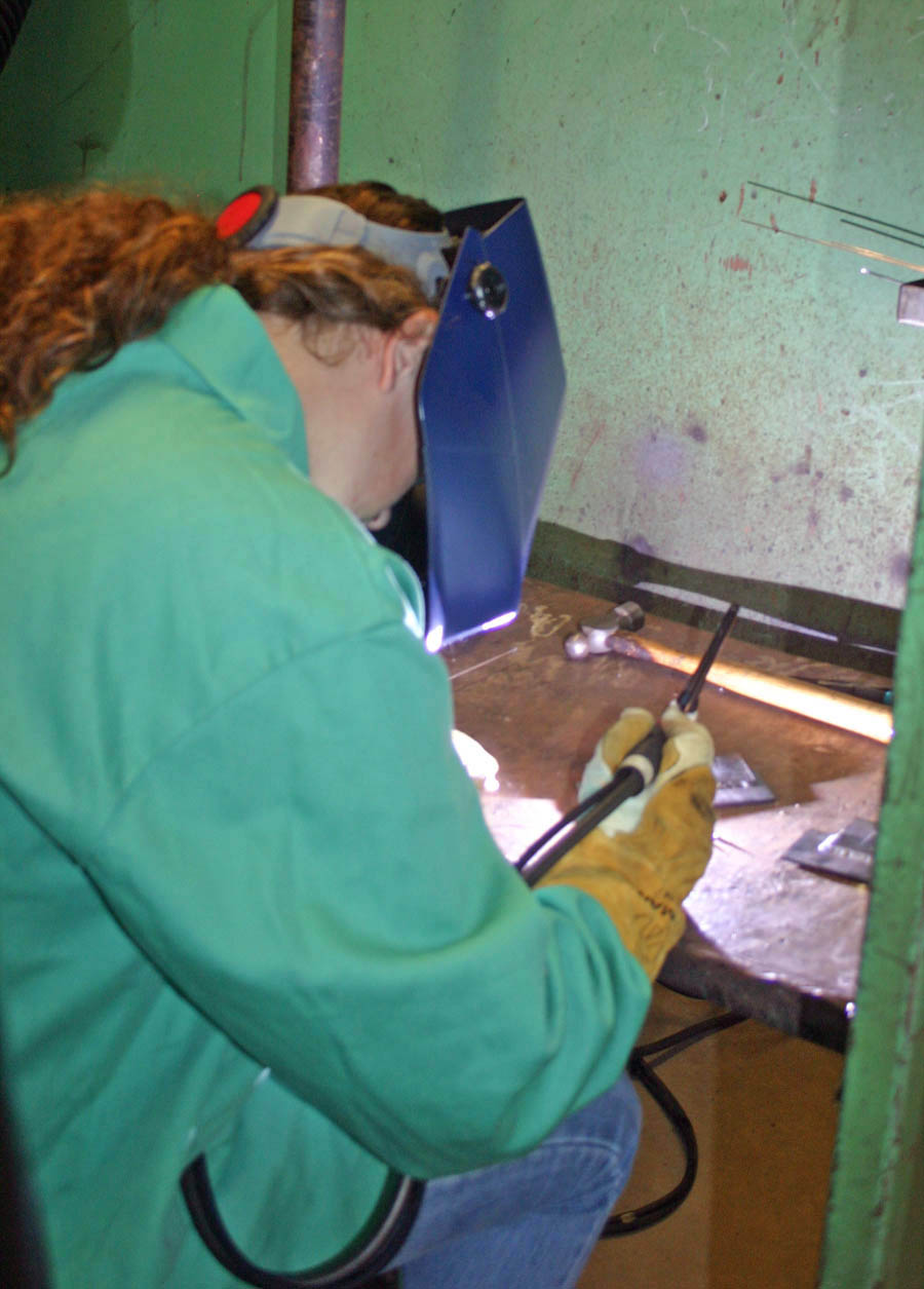 Click to enlarge,  Lee County High School student Briana Peterman practices gas tungsten arc welding in the Caterpillar Youth Apprenticeship Program's welding class at Central Carolina Community College's Lee County Campus. The apprenticeship program is a collaborative effort of the college, Lee County Schools, Caterpillar Inc.'s Sanford Fabrication Facility, and the N.C. Department of Labor. When students complete the two-year program, they will be skilled entry-level welders, ready to be hired by Caterpillar or other industries.
