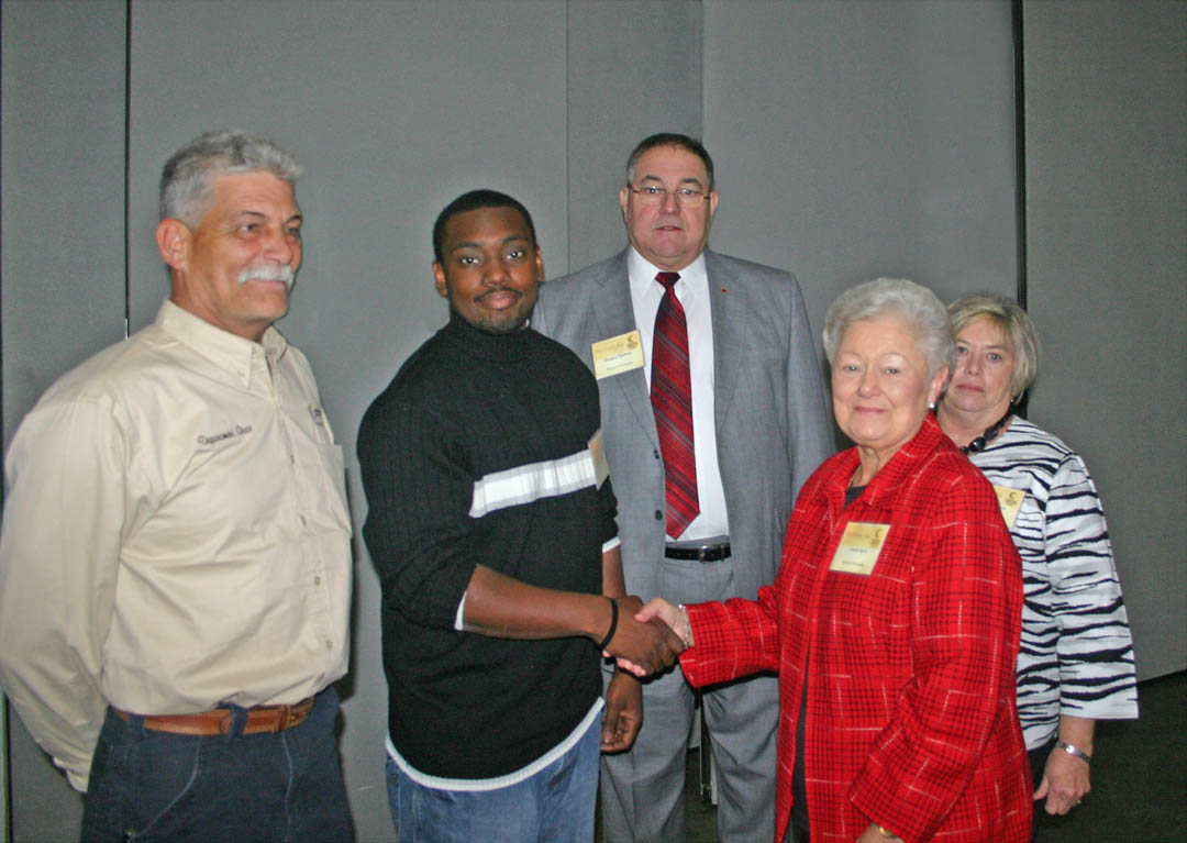 Click to enlarge,  Jonathan Womack (second from left), of Harnett County, an Automotive Systems Technology student at Central Carolina Community College, thanks the donors of the Troy Byrd Memorial Scholarship during the CCCC Foundation's Nov. 15 Scholarship Luncheon at the Dennis A. Wicker Civic Center. The scholarship is helping him get his education. Pictured (from left) are Chuck Mann, chair of the college's Transportation Technology Department; Womack; Reggie Denney, former president of the Automotive Service Association of North Carolina; Hazel Byrd, widow of Troy Byrd; and Brenda Denney, wife of Reggie Denney. The late Troy Byrd operated an auto repair business in Lillington for 52 years and had served as president of the Independent Garage Owners of North Carolina. The ASANC established the scholarship in his honor. The CCCC Foundation is a 501(c)(3) charitable organization affiliated with, but independent of, Central Carolina Community College. It receives donations of money and equipment on behalf of CCCC and uses them to promote the educational mission of the college and assist students through scholarships and grants. For information on establishing scholarships or endowments, contact CCCC Foundation Executive Director Diane Glover, 919-718-7231 or dglover@cccc.edu, or Associate Director Emily Hare, 919-718-7230 or ehare@cccc.edu. To apply for a scholarship, contact the CCCC Financial Aid Office at /www.cccc.edu/financialaid/ or 919-718-7229.