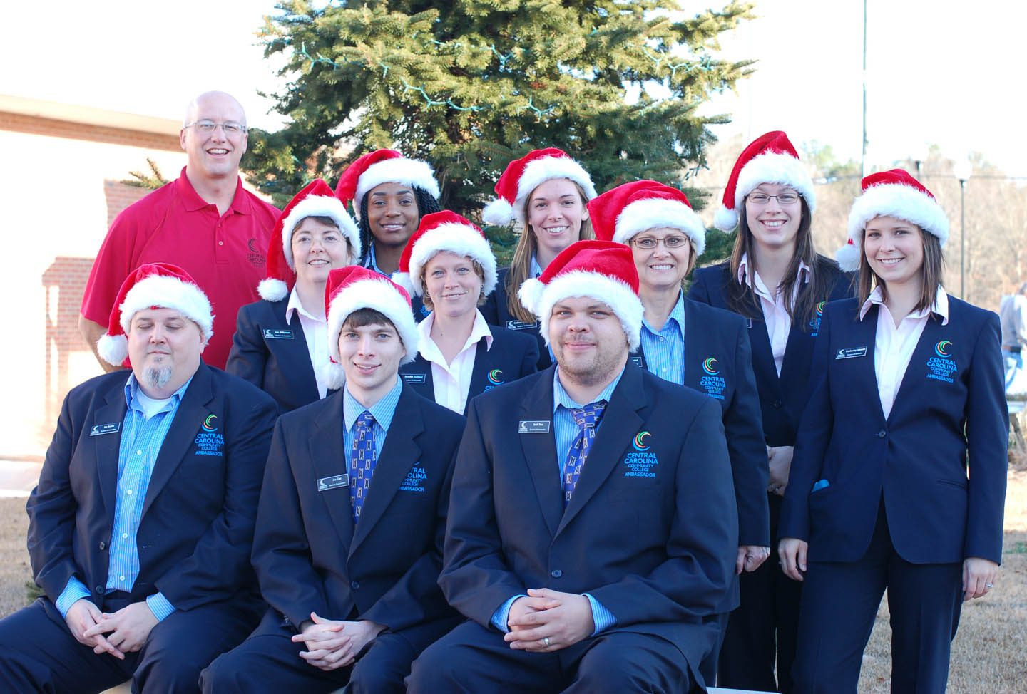 Click to enlarge,  Central Carolina Community College's Student Ambassadors in the holiday spirit. Ambassadors for the 2012-13 school year are (front, from left) Jonathan Stubbs, of Pittsboro; Joe Cox, of Siler City; Seth Tom, of Sanford; (second row, from left) Kim Wilkinson, of Durham; Jennifer Sanford Johnson, of Raleigh; Sandy Olmsted, of Cameron; Kimberley Laster Johnson, of Dunn; (back, from left) CCCC Student Activities Director/Athletics Director/Ambassador Advisor Mike Neal; Narrie Liverman, of Angier; Colleen Cunningham, of Sanford; and Ashley Volan, of Apex. To be an Ambassador, students must have good grade point averages, leadership potential, communication skills and be nominated by faculty or staff.