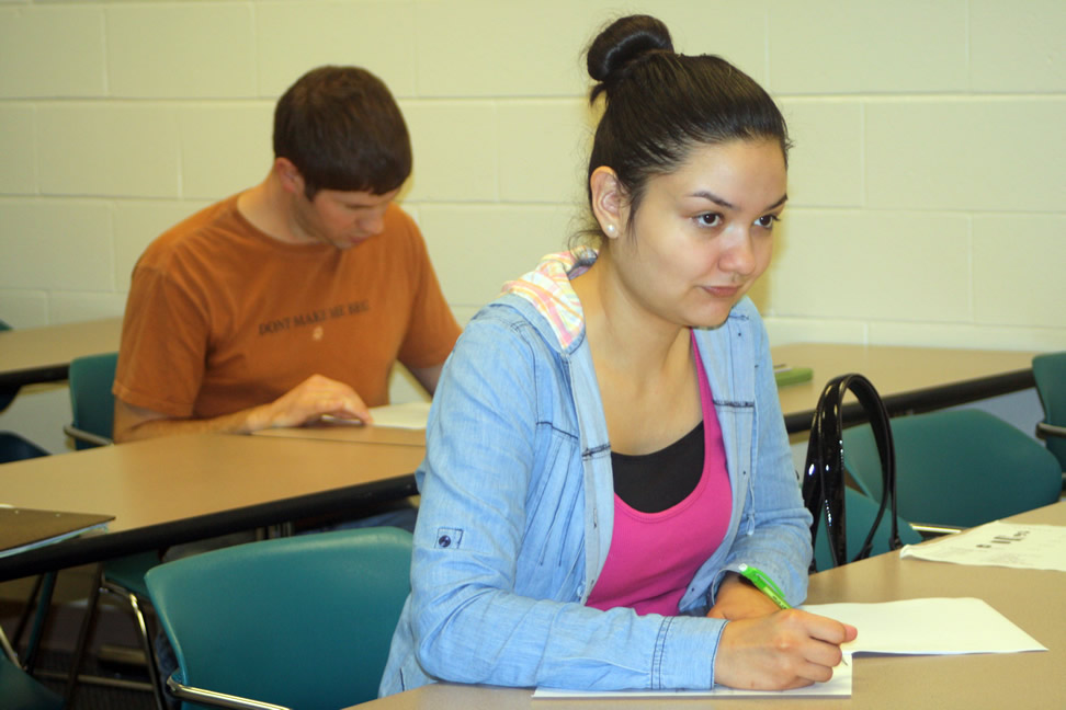 Click to enlarge,  On Tuesday, December 11, 2012, Central Carolina Community College students David Patrick Arp, of Fuquay-Varina, and Cynthia Molina, of Sanford, completed their final exams for CHI 111 Elementary Chinese I on the Lee Campus. CHI 111 introduces the fundamental elements of the Chinese language, and upon its completion students should be able to demonstrate a basic level of written and oral communication skills. Beginning February 2013, CCCC will offer CHI 111 as an online course offering, becoming the first community college in North Carolina to offer an online Chinese language course. For more information about CCCC's Chinese courses, visit www.cccc.edu/confucius.