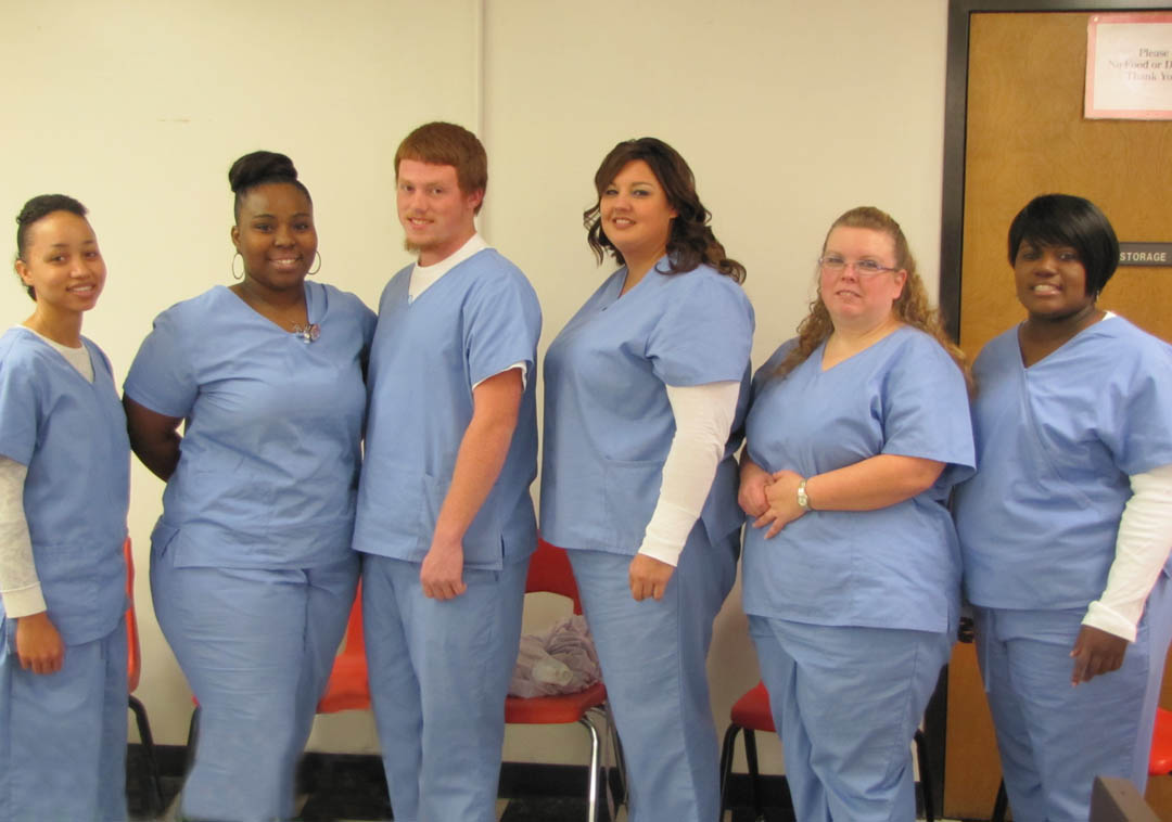 Click to enlarge,  Central Carolina Community College recognized its first graduating class of Basic Skills Plus Nurse Aide students at a pinning ceremony Dec. 13 at the college's Harnett County Campus, in Lillington. The students have or are also earning their high school or GED diplomas as well as Career Readiness Certificates in workplace skills. Pictured (from left) are graduates Nicole Thomas, Jalisa Hayes, and Dominic Carucci, all of Harnett County; Marsha Sander, of Sampson County; Ruby Guzman, of Harnett County; and Renee Brown, of Cumberland County. For more information about the Basic Skills Plus program, contact Andre Mapp at amapp@cccc.edu or call 919-718-7339.