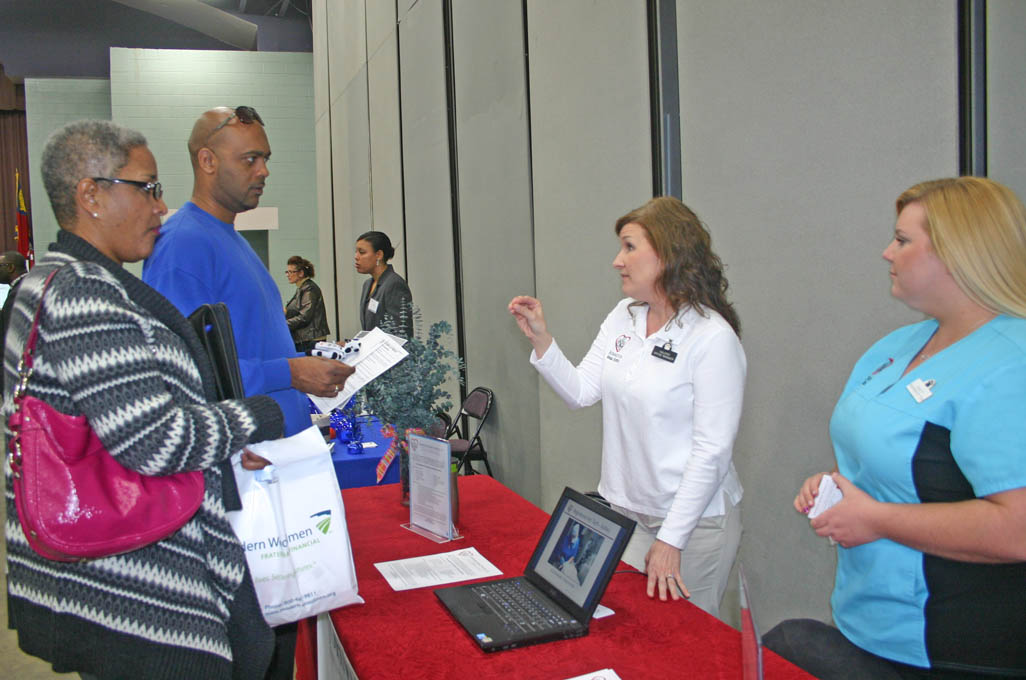 Click to enlarge,  Tonia Jones (left), of Angier, and David Saldy, of Erwin, Medical Office Administration students at Central Carolina Community College, visited the college's March 13 Career Fair at the Dennis A. Wicker Civic Center to speak with some of the approximately 70 employer vendors who participated. Johnston Animal Hospital office manager Valerie Price (center) and Registered Veterinary Technician Ashley Worley spoke with them about the variety of positions the hospital has. Worley is a 2010 graduate of CCCC. The Career Fair was sponsored by the college's Career Center. For more information about the services the Center offers, call 919-718-7396 or go to www.cccc.edu/careercenter/.