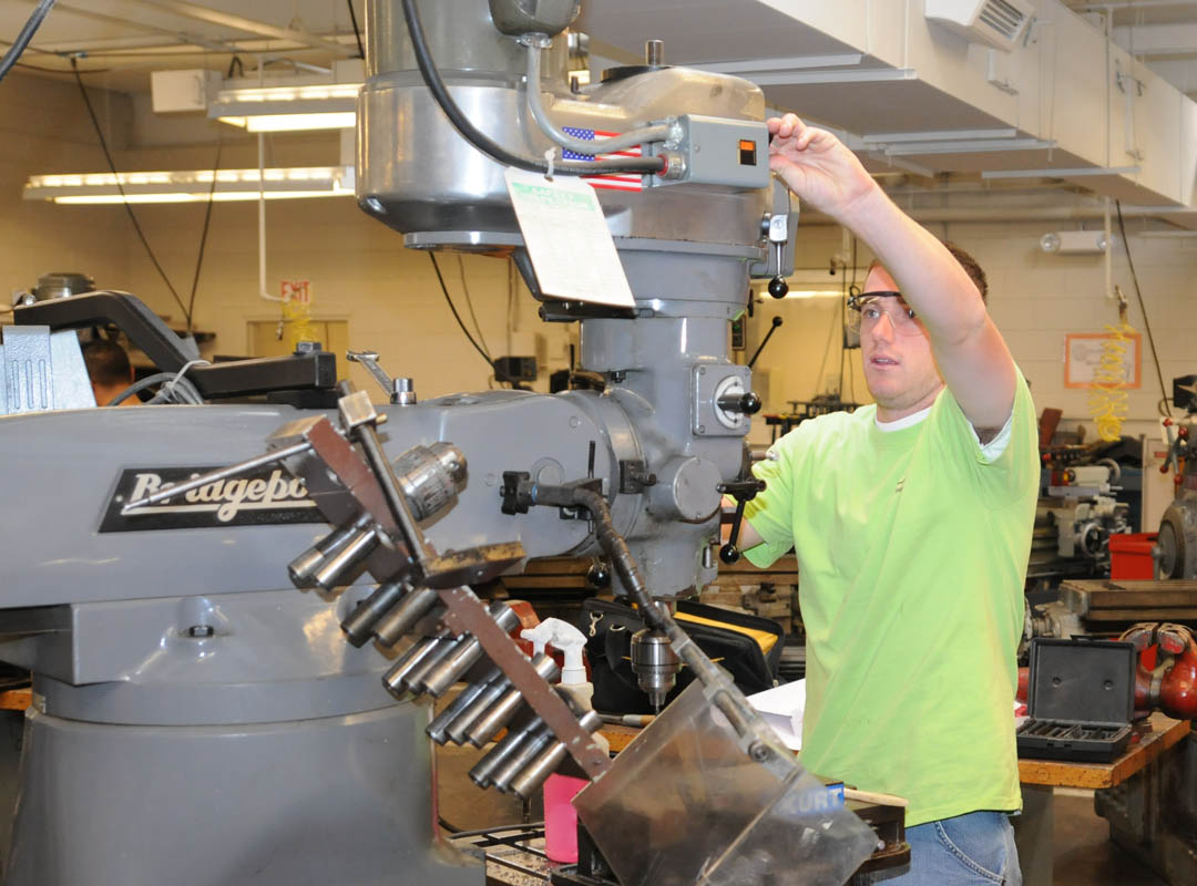 Click to enlarge,  Jared Gibson, of Lee County, a student in Central Carolina Community College's Computer Integrated Machining program, works with a vertical milling machine in the Machine Shop at the Lee County Campus. During North Carolina Advanced Manufacturing Week, April 8-14, the college is hosting open houses for its manufacturing programs at its campuses in Lillington, Sanford and Pittsboro. The open houses will be held in Lillington from 5 p.m.-7 p.m. Monday, April 8; in Sanford from 5 p.m.-7 p.m. Tuesday, April 9; and in Pittsboro from 5 p.m.-7 p.m. Thursday, April 11. For more information about any of the open houses, contact Dean Stephen Athans at    sathans@cccc.edu or 919-718-7287. For more information about advanced manufacturing in North Carolina, visit www.ctpnc.org/manufacturing. This site links to more information about manufacturers and manufacturing careers.