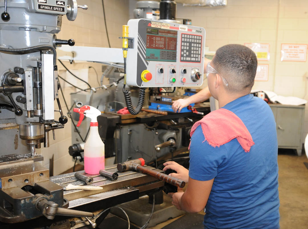 Click to enlarge,  A Central Carolina Community College machining student operates a manual mill with electronic read-out during a class in Computer Integrated Machining. For the quality of its Machining program, CCCC has been recognized by The Manufacturing Institute as a charter member of its 'M-List.' Only 39 institutions of higher learning nationwide made the list, recognizing that they train students to meet National Association of Manufacturers-Endorsed Manufacturing Skills Certifications as a standard part of their manufacturing education programs. For more information about Central Carolina Community College's manufacturing training and other programs, visit www.cccc.edu/curriculum.