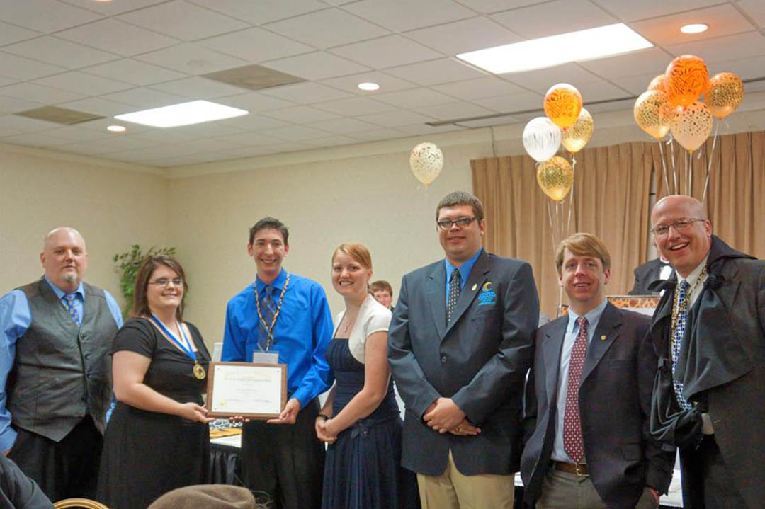 Click to enlarge,  Student officers and advisors of Central Carolina Community College's chapter of the Phi Theta Kappa International Honor Society (left) President Jonathan Stubbs, of Chatham County, and (starting third from left) Recording Secretary Zachary White, of Harnett County, Treasurer Kimberly Guin, of Lee County, Vice President Seth Tom, of Chatham County, and advisors Mark Hall and Mike Neal, display the Five Star Level Award plaque presented to them at the PTK's regional conference. Pictured with them is a Phi Theta Kappa Carolinas Region officer (second from left). Five Star is the highest level in the society's Chapter Development Plan, requiring the chapter members to meet high standards for chapter activity and college and community service. Phi Theta Kappa is the official honor society for two-year colleges and the largest honor society in American higher education. CCCC's chapter currently has 225 members. For more information about PTK's Beta Sigma Phi Chapter, visit www.cccc.edu and click on the A-Z index for Phi Theta Kappa, or contact Mark Hall, mhall@cccc.edu or 919-781-7422, or Mike Neal, mneal@cccc.edu or 919-718-7337.