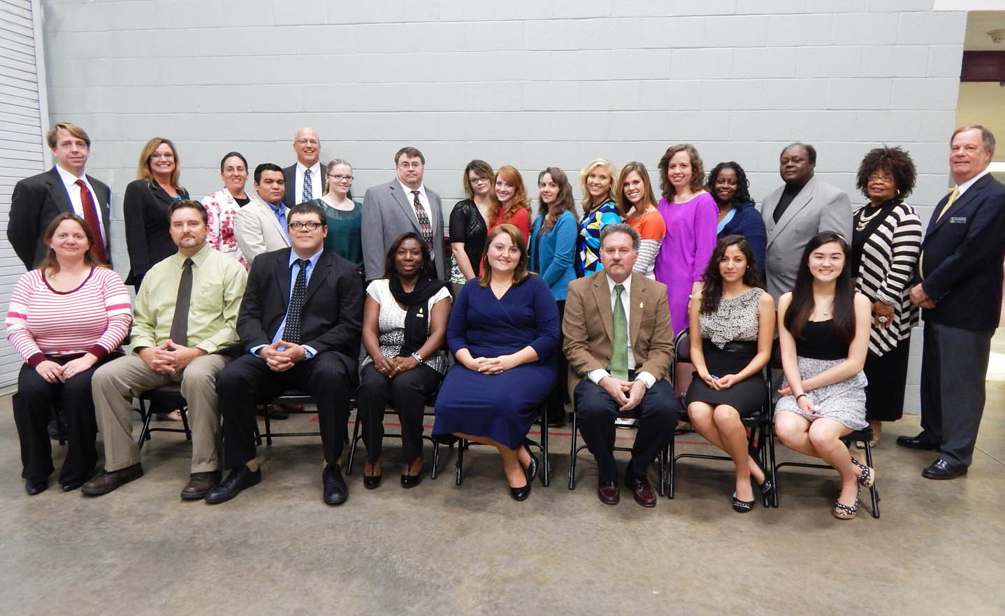 "Click to enlarge,  Central Carolina Community College's chapter of the Phi Theta Kappa International Honor Society celebrated the induction of 28 new members during an Oct. 29 ceremony at the Dennis A. Wicker Civic Center. The fall inductees (not pictured in order) are: Eric Brinkman, Elizabeth Budny, Erica Davidson, Scott Duff, Lori Dunlap, Oscar Hernandez, Michael Johnson, Anastasia Krick, Madison Lilly, Amy Mauldin, Teresa Priestner, Tonia Rogers, and Katelin Zimmerman, all of Lee County; Patricia Nettles, Logan Brooks, Ronnie Ross, Ashley Crosby, Emily Humphries and Angela Humphries, all of Chatham County; David McAllister, of Harnett County; Leah Dannelley and Laura Diver, both of Moore County; Ashley Alderson, Rhonda Hamilton, Nicholas Heurich, Jeremy Knoll, and Elma Matthews, all of Cumberland County; and Erin O'Rawe, of Wake County. Pictured with the inductees who attended the ceremony are the chapter officers (first row, starting third from left) Seth Tom, of Lee County, treasurer; Koren Hailey, vice president-Harnett County; Mary Cooper, of Lee County, president; Eric Brinkman, vice president-Lee County; and Nathalia Cruz, of Lee County, recording secretary. Others pictured with the inductees are co-advisors Mark Hall (back, left) and Mike Neal (back, fourth from left); guest speaker Margaret Murchison (back, second from right), WWGP Broadcasting Corp. News and Public Services director; and (back, right) CCCC President Bud Marchant. Phi Theta Kappa is the official honor society for two-year colleges and the largest honor society in American higher education. For more information about Phi Theta Kappa at CCCC, contact Mark Hall at mhall@cccc.edu or 919-718-7422; Mike Neal at mneal@cccc.edu or 919-718-7337, or visit www.cccc.edu and click on ""Phi Theta Kappa Honor Society"" in the ""A-Z Index."""