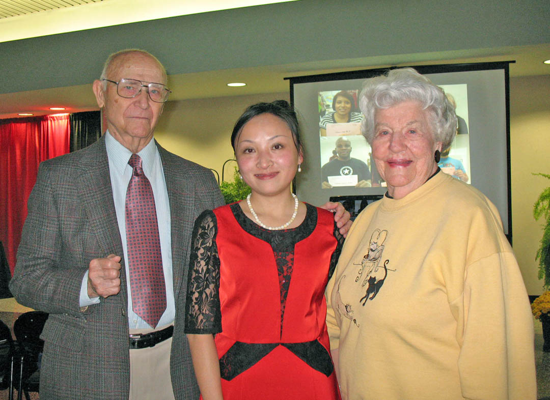 Click to enlarge,  Central Carolina Community College Confucius Classroom instructor Guan Wang (center) is greeted by Bob Brickhouse (left), CCCC trustee from 1971 to 1987, and Virginia Hester, a CCCC Foundation donor, both of Lee County, at an Oct. 28 welcome reception in her honor at the Dennis A. Wicker Civic Center. Wang, a professor of English at the University of Sichuan in Chengdu, China, will be with the Classroom for three years. To schedule a CCCC Confucius Classroom presentation for an organization or school, contact confucius@cccc.edu. For more information about the Classroom, visit www.cccc.edu/confucius.