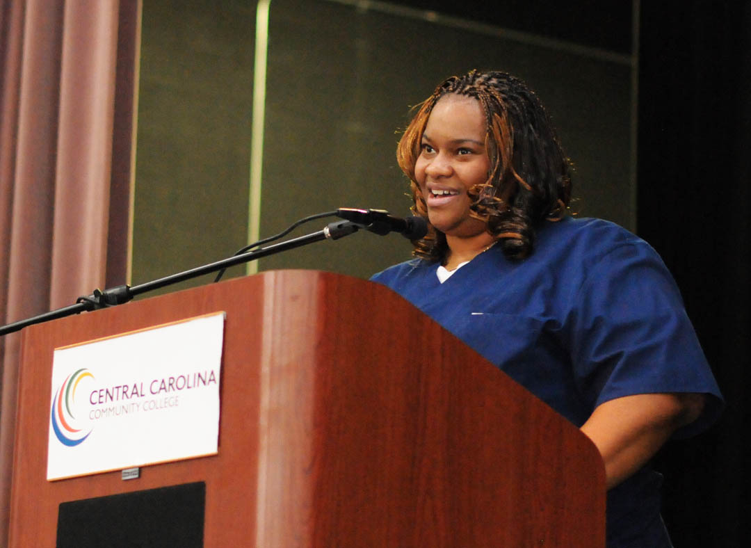 Click to enlarge,  Tasha Dickerson, of Chatham County, addresses the Central Carolina Community College Continuing Education Department's Medical Programs graduation Dec. 12 at the Dennis A. Wicker Civic Center. Dickerson received her Nurse Aide I Certificate. More than 400 students completed their studies for their certificates in a variety of medical programs during the fall semester. For more information about Continuing Education medical programs at CCCC, call 919-545-8044 in Chatham County, 910-814-8823 in Harnett County, or 919-777-7793 in Lee County. For information on spring Continuing Education programs, see the schedule online at www.cccc.edu/ecd/schedule/.