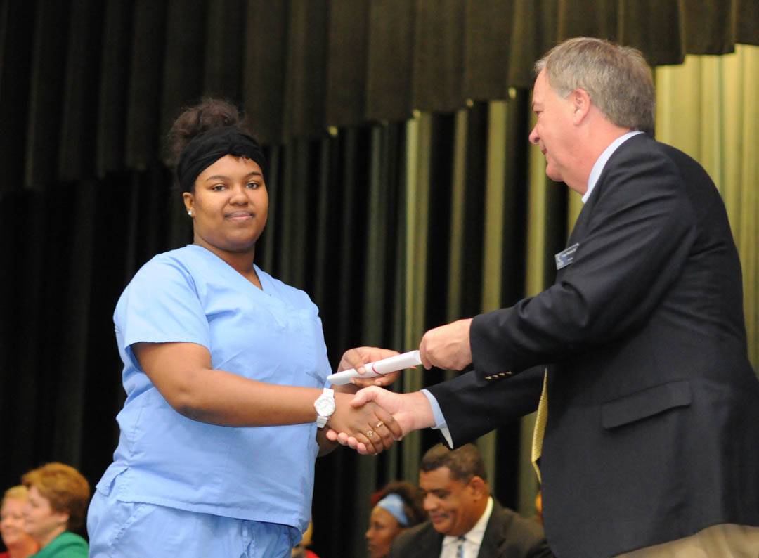 Click to enlarge,  Central Carolina Community College President Bud Marchant (right) presents Fredericka Berryman, of Harnett County, with her Nurse Aide I Certificate at the college's Continuing Education Department's Medical Programs graduation Dec. 12 at the Dennis A. Wicker Civic Center. More than 400 students completed their studies for their certificates in a variety of medical programs during the fall semester. For more information about Continuing Education medical programs at CCCC, call 919-545-8044 in Chatham County, 910-814-8823 in Harnett County, or 919-777-7793 in Lee County. For information on spring Continuing Education programs, see the schedule online at www.cccc.edu/ecd/schedule/.