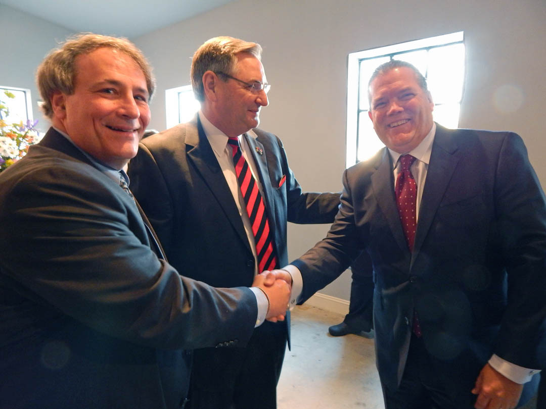 Click to enlarge,  Julian Philpott (left) chair of the Central Carolina Community College Board of Trustees,  and Jim Burgin, Harnett County Commissioner and CCCC trustee, congratulate Kirk Bradley, head of fundraising for the Central Carolina Works initiative and chairman, president and CEO of Lee-Moore Capital Company, on his success in spearheading the C.C. Works fundraising at a Feb. 19 reception in Sanford. More than $670,000 of the $750,000 goal has been raised, primarily through Bradley's tireless efforts. He was presented a plaque of appreciation at the reception. Central Carolina Works, a partnership of CCCC, public schools in Chatham, Harnett and Lee counties, government, business, and industry, will fund the placement of Academic and Career Advisors in each of the public high schools in Chatham, Harnett and Lee counties starting in the fall. These advisors will work one-on-one with students to help them enroll, tuition-free, in college classes that will move them toward their vocational and educational goals. For more information about Central Carolina Works, visit www.cccc.edu/ccworks. Contributions to the Central Carolina Works initiative can be made through the CCCC Foundation, a 501(c)(3) charitable organization affiliated with, but independent of, Central Carolina Community College. For information, contact Emily Hare, director of the CCCC Foundation and Development Office, 919-718-7230 or ehare@cccc.edu.