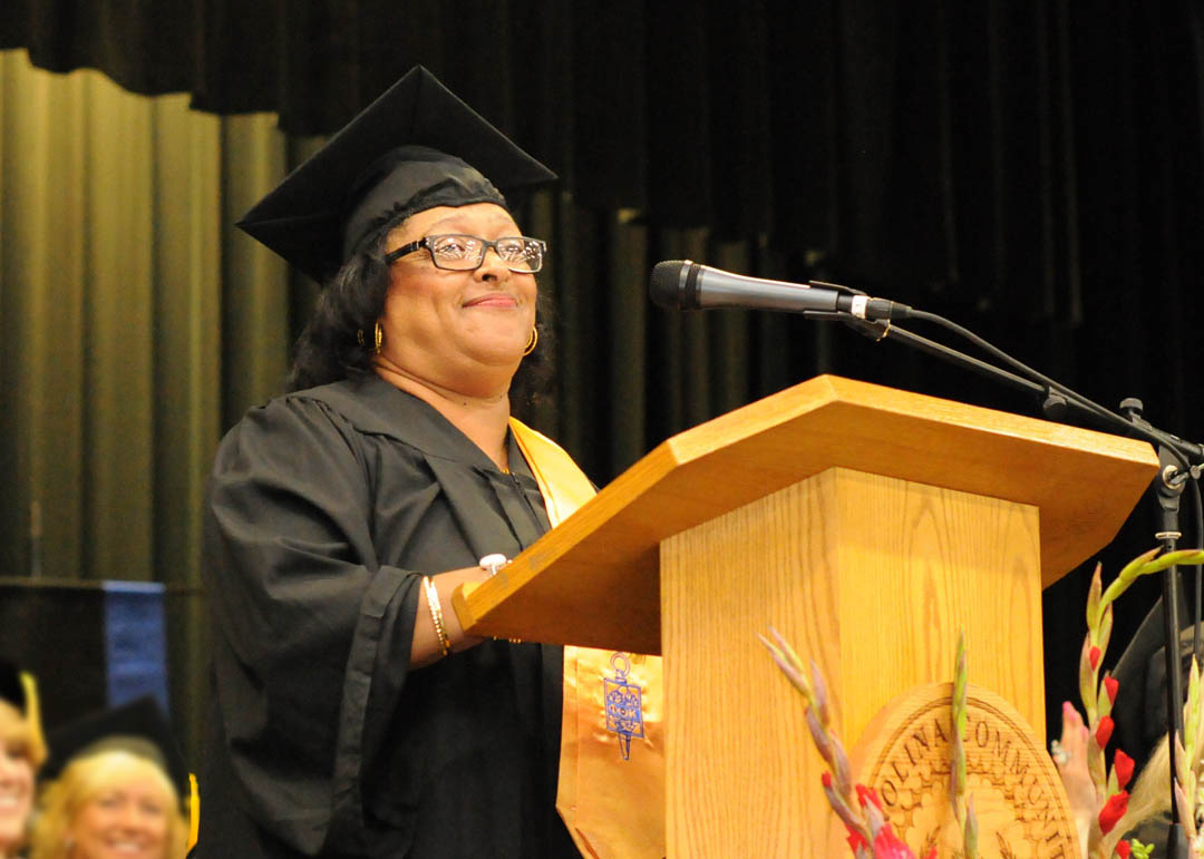 Click to enlarge,  Vivian Smith, of Harnett County, delivers one of the graduating student addresses at Central Carolina Community College's May 22 Spring Commencement at the Dennis A. Wicker Civic Center. Smith received her Diploma in Cosmetology. The college awarded 315 associate degrees, and 421 diplomas and certificates, with some students receiving multiple credentials. Pictures from the commencement exercises can be downloaded in a few days from www.cccc.edu. The commencement can also be viewed online at 4CNCLive.com. For information on what CCCC offers, visit www.cccc.edu/.