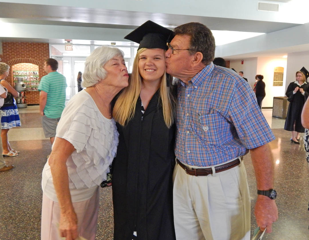 Click to enlarge,  Lauren Jernigan (center), of Harnett County, gets a hug from her grandparents, Diane and Earl Parrish, after receiving her Associate in Applied Science in Veterinary Medical Technology at Central Carolina Community College's May 22 Spring Commencement at the Dennis A. Wicker Civic Center. The college awarded 315 associate degrees, and 421 diplomas and certificates, with some students receiving multiple credentials. Pictures from the commencement exercises can be downloaded in a few days from www.cccc.edu. The commencement can also be viewed online at 4CNCLive.com. For information on what CCCC offers, visit www.cccc.edu/.