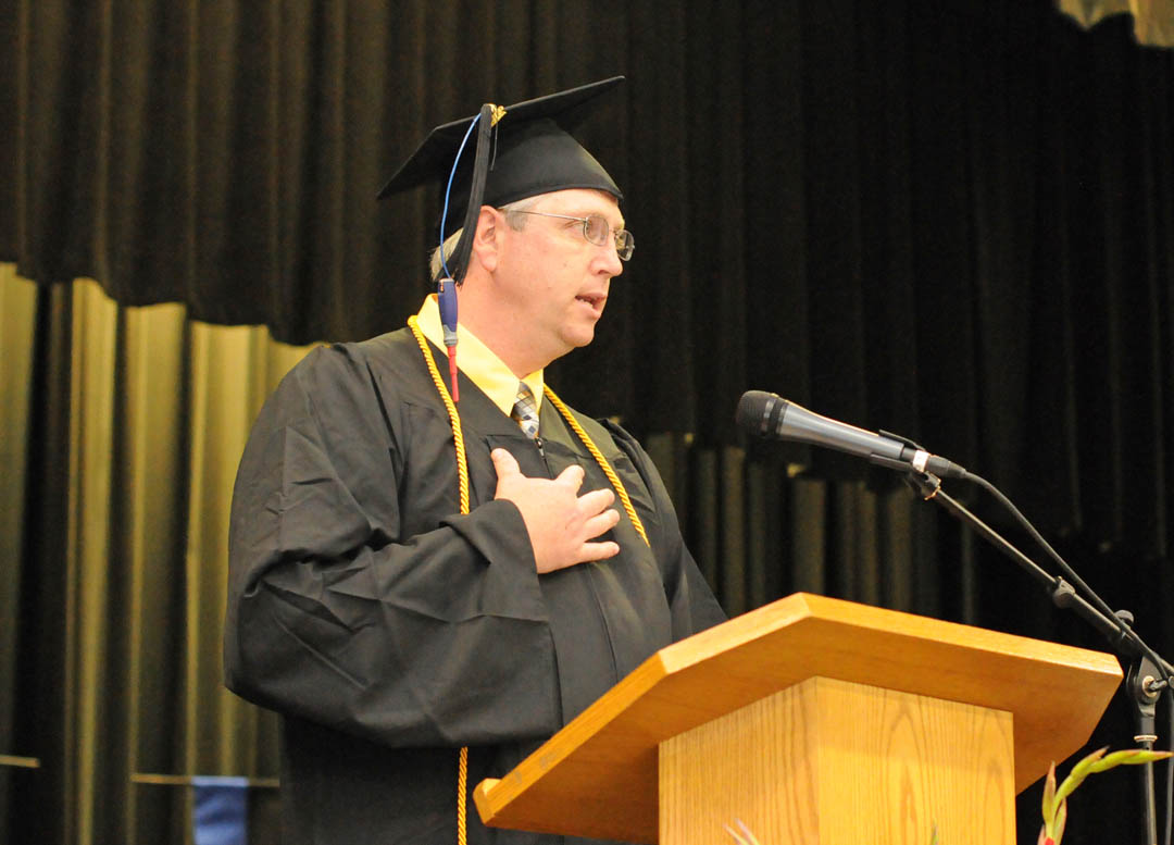Click to enlarge,  Scott Butcher, of Chatham County, delivers one of the graduating student addresses at Central Carolina Community College's May 22 Spring Commencement at the Dennis A. Wicker Civic Center. Butcher received his Associate in Applied Science in Industrial Systems Technology. The college awarded 315 associate degrees, and 421 diplomas and certificates, with some students receiving multiple credentials. Pictures from the commencement exercises can be downloaded in a few days from www.cccc.edu. The commencement can also be viewed online at 4CNCLive.com. For information on what CCCC offers, visit www.cccc.edu/.