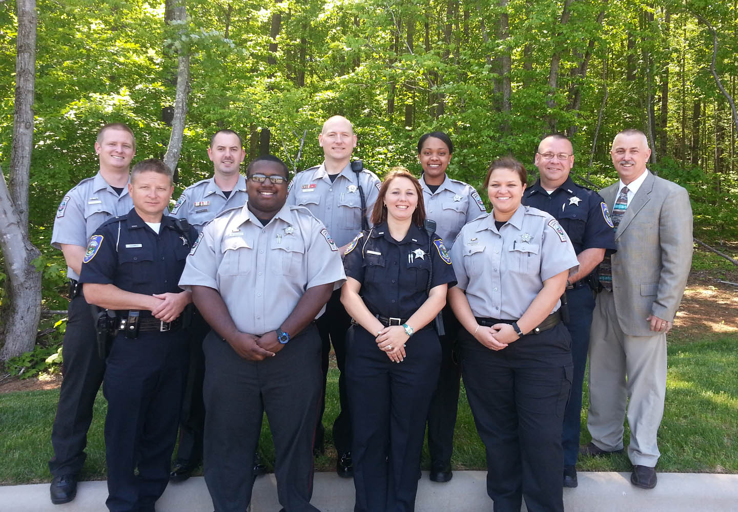 Click to enlarge,  Officers from the Chatham and Randolph counties sheriff offices graduated from Central Carolina Community College's Detention Officer School on Thursday May 8. Pictured (front, from left) are graduates Deputy Steve Shawver, of Randolph; Detention Officer (D.O.) Bradley McKinney, of Chatham; D.O. Tiffany Barringer, of Randolph; and D.O. Abby Howard, from Chatham; and (back row, from left) D.O. Reid Kirkman, Lt. Brandon Jones, Lt. Erik Lindley, and D.O. Brittany Caddell, all of Chatham; D.O. David McNeill, of Randolph; and Detention Officer School Director Capt. Doug Stuart, Chatham County Sheriff's Office. The graduates received 168 hours of instruction in the 23-day program. The course concluded with the state exam and certification, on which the officers attained an average score of 89.2.  For more information about the Detention Officer School, contact Larry Foster, CCCC's Emergency Services Training Center Law Enforcement coordinator, at 919-777-7772 or by email at lfoster@cccc.edu.