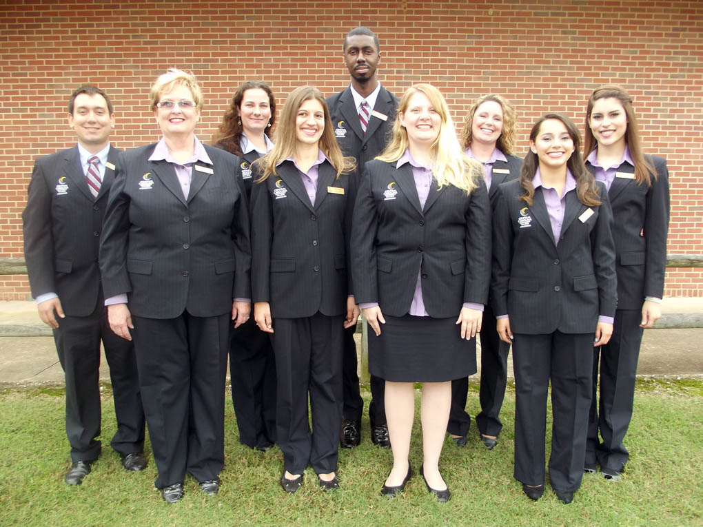 Click to enlarge,  Nine students will represent Central Carolina Community College as Ambassadors for 2014-2015. Academic performance, leadership potential, and communication skills are all factors in the selection process. This year's Ambassadors are, left to right: front row, Gail Brown, of Dunn; Katie Wilson, of Sanford; Allison Eyring, of Lillington; and Marcela Hernandez, of Sanford; back row, Al DeLong, of Eastover; Kimberly Rains, of Carthage; Ryan Belk, of Sanford; Tiffany Streeter, of Fort Bragg; and Genesis Santini, of Sanford.   Services provided by the Ambassadors may include assisting with high school student campus visits, serving as a guide for individuals and groups touring campus, hosting campus activities, recruiting students, speaking to community groups and agencies, assisting with Foundation activities, assisting with registration, graduation, and orientation, and assisting with student activities.