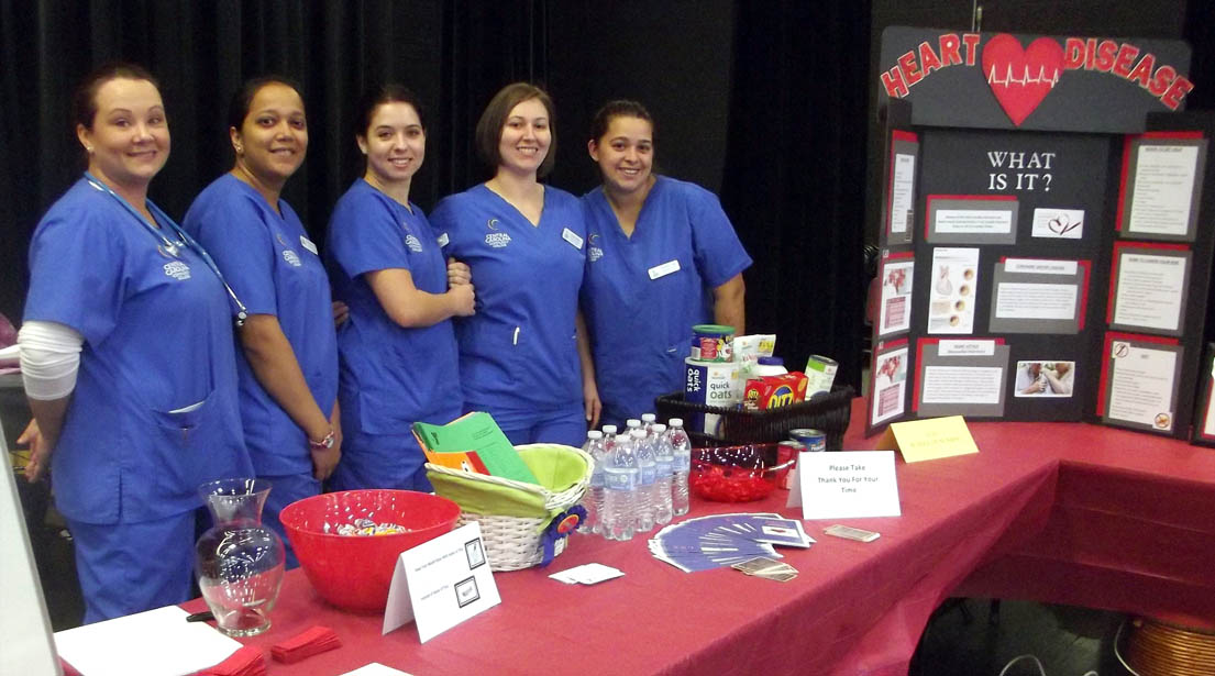 "Click to enlarge,  These Central Carolina Community College nursing students - Joni Williams, Mallika Patel, Karen Wakefield, Jessica Dudley, and Michelle Page - greeted visitors to the ""Heart Disease: What Is It?"" booth at the Lee County Schools/Central Carolina Community College Employee Health & Benefits Fair on Nov. 4 at the Dennis A. Wicker Civic Center in Sanford. For more information on the CCCC nursing program, call 919-718-7461 or go to the college website at www.cccc.edu."
