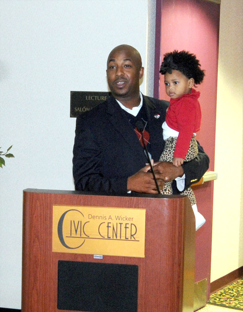 Click to enlarge,  Spring Lake Mayor Chris V. Rey, pictured with his daughter, was guest speaker for the Veterans College Fair on Friday, Nov. 14, at the Dennis A. Wicker Civic Center in Sanford. For more information on the CCCC Veterans Upward Bound program, call 919-718-7463, email veteransub@cccc.edu, or visit the program's website www.cccc.edu/vub/.