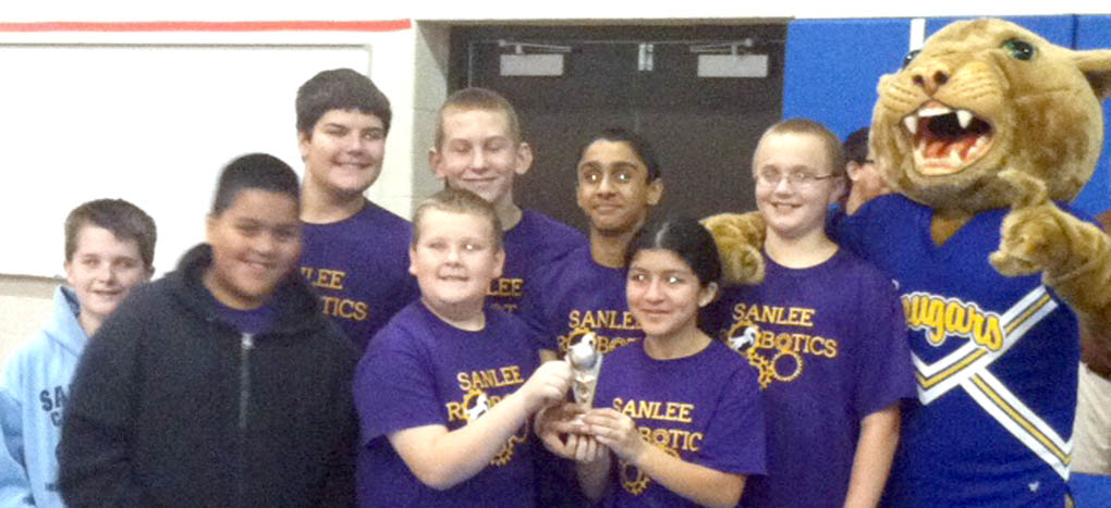 Click to enlarge,  The SanLee Middle School robotics team won a trophy for Teamwork at the middle school robotics competition held Nov. 15 at Central Carolina Community College.