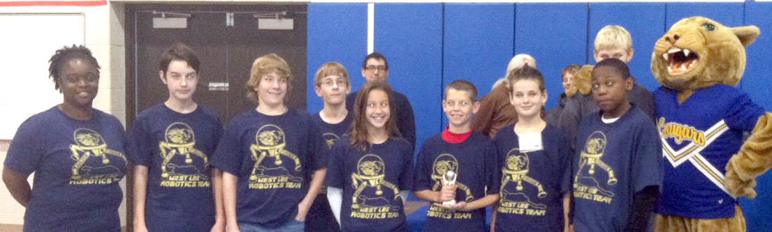 Click to enlarge,  The West Lee Middle School robotics team won a trophy for Best Robot Performance at the middle school robotics competition held Nov. 15 at Central Carolina Community College.