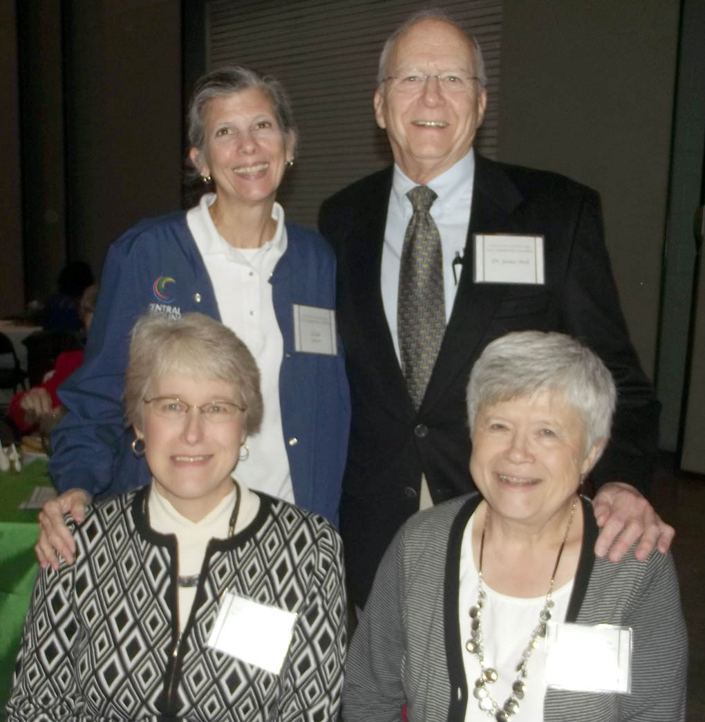 Click to enlarge,  Dr. James B. Holt (upper right) visits with scholarship recipient Lisa Janson (upper left), and Sherry Knepper (lower left) and Judy Poe (lower right) during the college's 2014 Scholarship Luncheon, held Nov. 19 at the Dennis A. Wicker Civic Center in Sanford.
