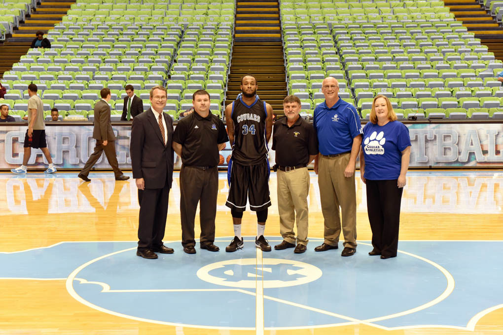 Click to enlarge,  Central Carolina Community College's Vice President of Student Services Ken Hoyle, Assistant Coach Brian Hurd, Player Marquise Richmond, Head Coach Doug Connor, Athletic Director Mike Neal, and Dean of Student Support Services Heather Willett were pictured at this year's game with the UNC JVs at the Dean Smith Center in Chapel Hill.
