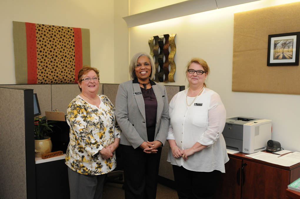 Click to enlarge,  Ramona Leftwich (center), Coordinator of the Student Support Center at Central Carolina Community College, joins staff members Susan Carlson (left) and Linda Rhodes (right) in the new Center located in Budd Hall on the Lee County Campus. Hours of operation are Monday through Thursday from 8 a.m. to 6 p.m., and Fridays from 8 a.m. to 3:30 p.m. Continuing Education students may access the Student Support Center by calling 919-718-7500.