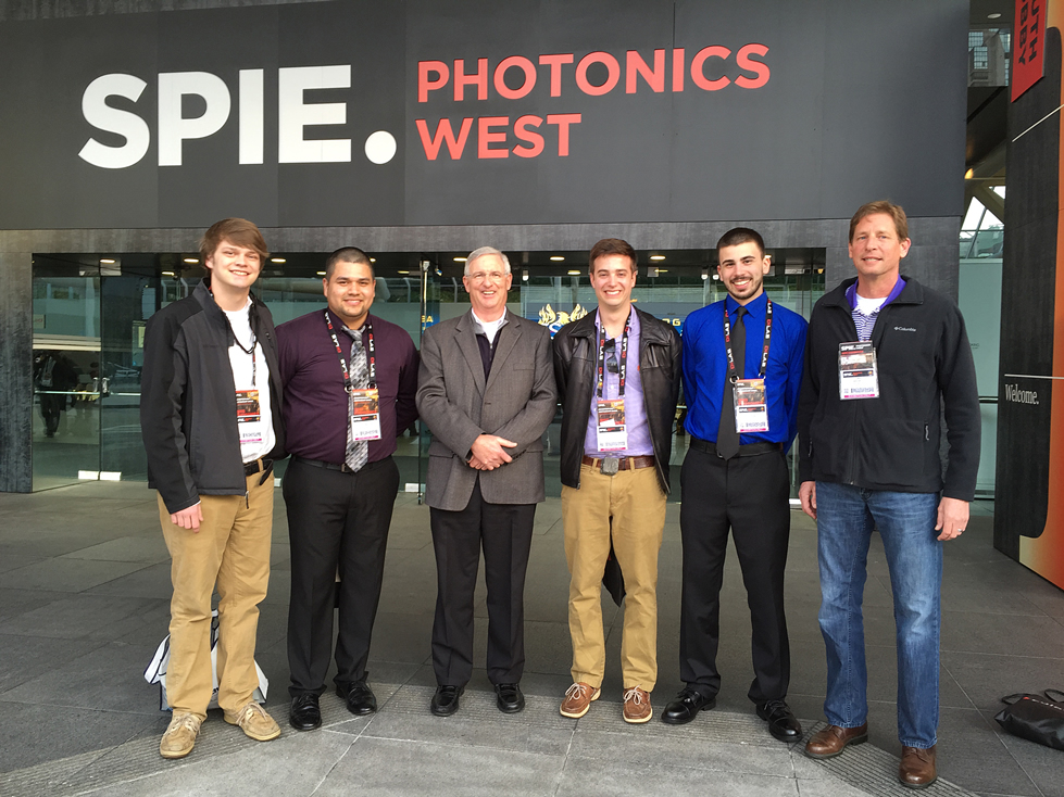 Click to enlarge,  Second-year students in the Laser and Photonics Technology program at Central Carolina Community College's Harnett Campus attended the 2015 SPIE Photonics West Convention in San Francisco. Pictured are, left to right: Colt Dudley, Carlos Salas Moreno, Gary Beasley (lead instructor), Alex Voytik, Chris Loehr, and Chris Baggett.