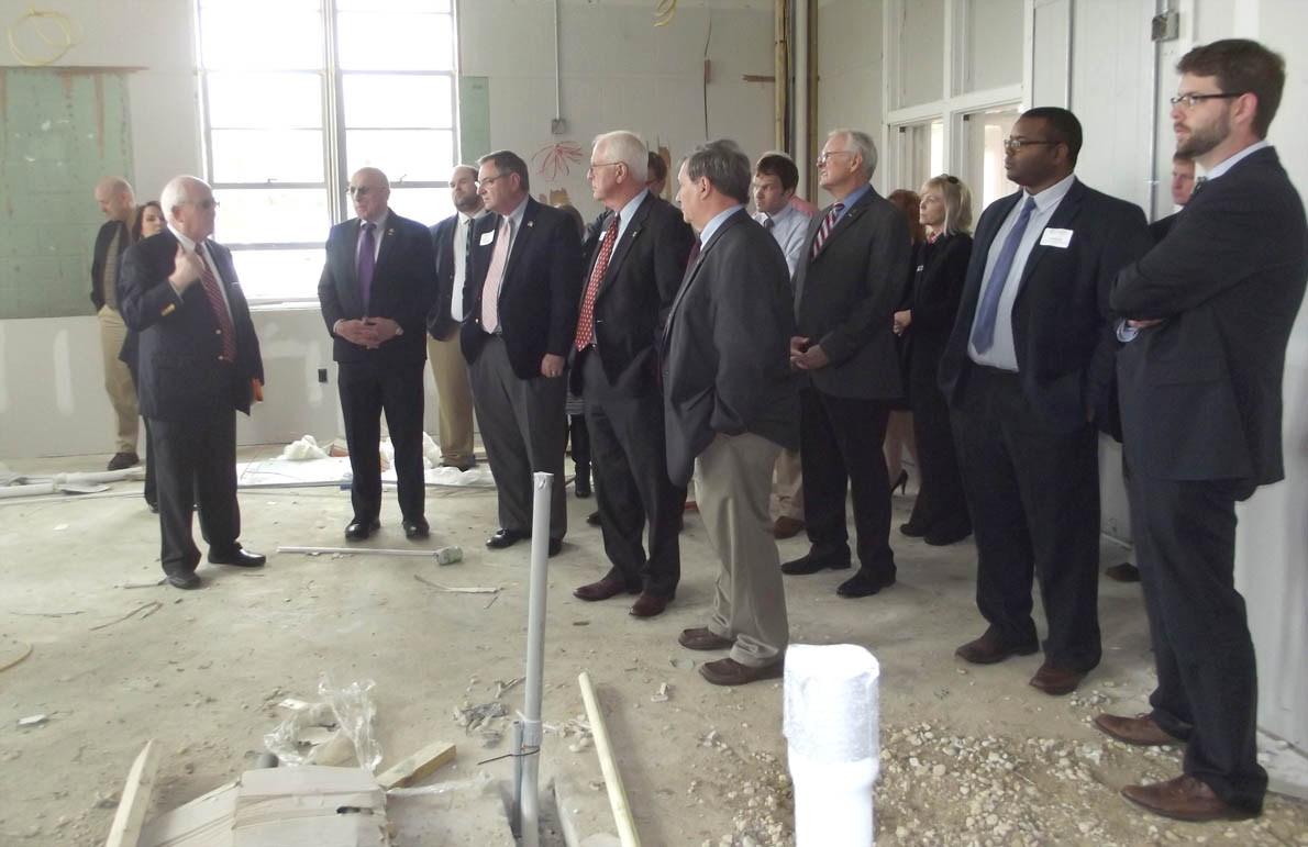 Click to enlarge,  Bill Tyson (at left), Central Carolina Community College Harnett County Provost, shows off one of the facilities that the college will utilize at the Dunn Center.