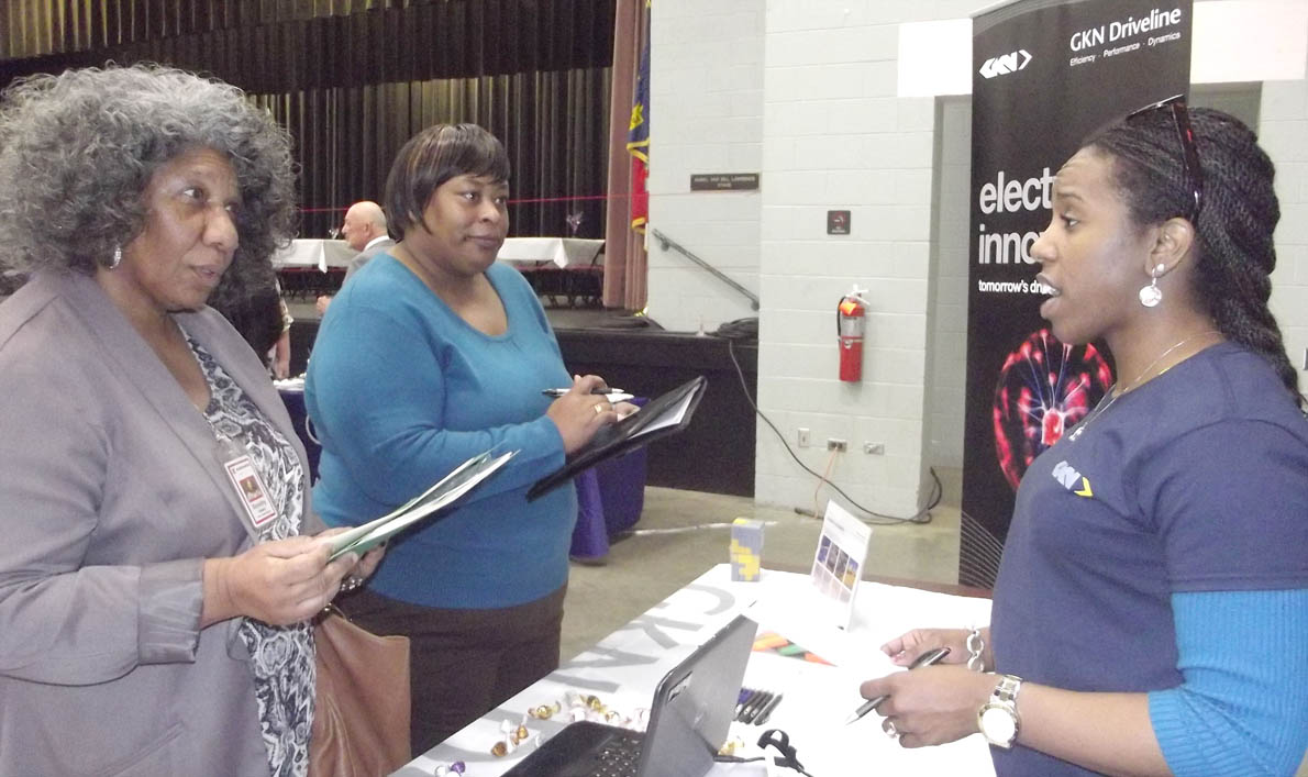 Click to enlarge,  Tyesha White, right, who is Human Resources Manager with GKN Driveline, visits with Dorothy Hawes and Viva Quick, both of Sanford, during the Central Carolina Community College Career Fair, which was held Thursday, March 19, at the Dennis A. Wicker Civic Center in Sanford. The CCCC Career Services Center is open 8 a.m. to 5 p.m. Monday through Thursday, and 8 a.m. to 3:30 p.m. Friday. To schedule an appointment or for more information, people can contact the Lee County Center at 919-718-7396, the Harnett County Center at 910-814-8834, or the Chatham County Center at 919-545-8054. Or, visit the CCCC website at www.cccc.edu/careercenter.