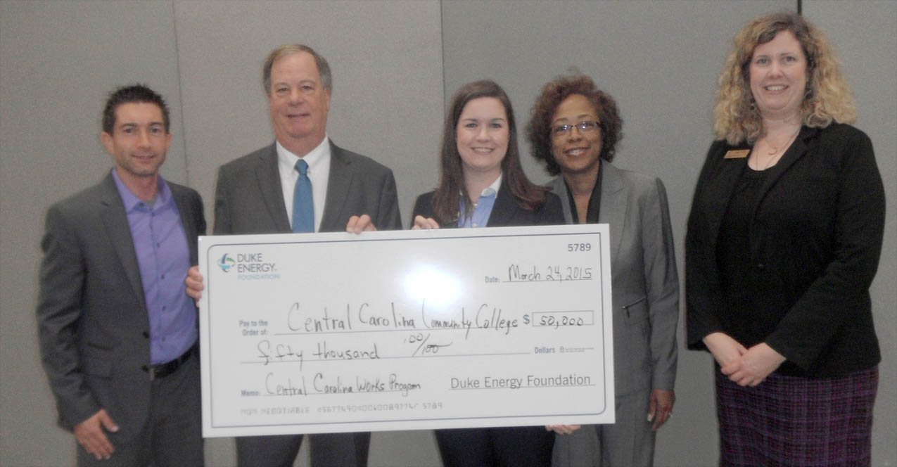 Click to enlarge,  Duke Energy District Manager Indira Everett (second from right) has presented a $50,000 grant check to Central Carolina Community College for the Central Carolina Works initiative. Receiving the check on behalf of the college were (from left) Chris Ehrenfeld, CCCC Foundation Director; CCCC President Dr. T.E. Marchant; Emily Hare, CCCC Foundation executive director; and Virginia Brown, CCCC Director of Secondary Partnerships. For more information about Central Carolina Works, visit www.cccc.edu/ccworks or contact Virginia Brown at 919-718-7370 or vbrown@cccc.edu. For information about the college and its programs, visit www.cccc.edu. Contributions to the Central Carolina Works initiative can be made to the CCCC Foundation, a 501(c)(3) charitable organization affiliated with, but independent of, the college. It receives donations of money and equipment on behalf of CCCC and uses them to promote the educational mission of the college and assist students through scholarships and grants. For information on giving to the Foundation, contact Emily Hare, CCCC Foundation executive director, 919-718-7230 or ehare@cccc.edu.