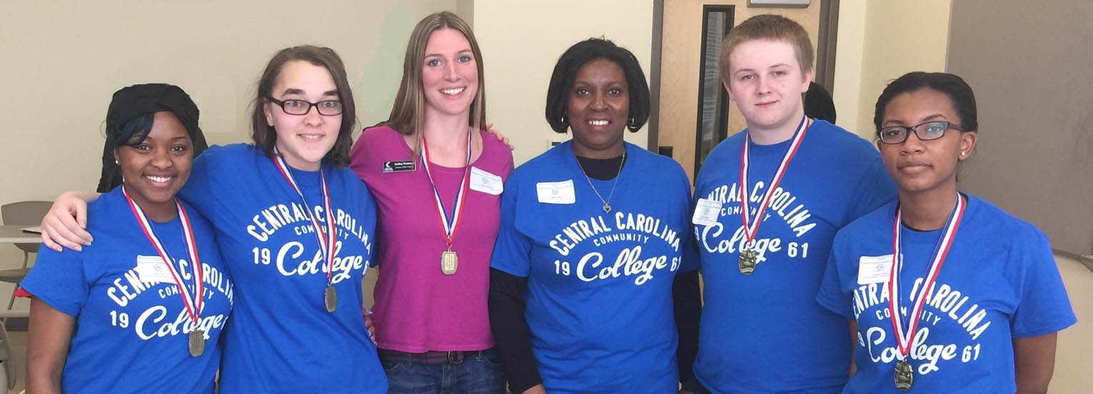 Click to enlarge,  Members of Central Carolina Community College's Upward Bound Math & Science Scholars' Bowl team from Harnett County Schools are pictured, left to right: Kiara Jones, Kayla Johnson, Ashley Tittemore (coach), Peggy Cotton (parent chaperone), Jeremy Walker, and Christie Cotten. Not pictured, Kayla Coleman.