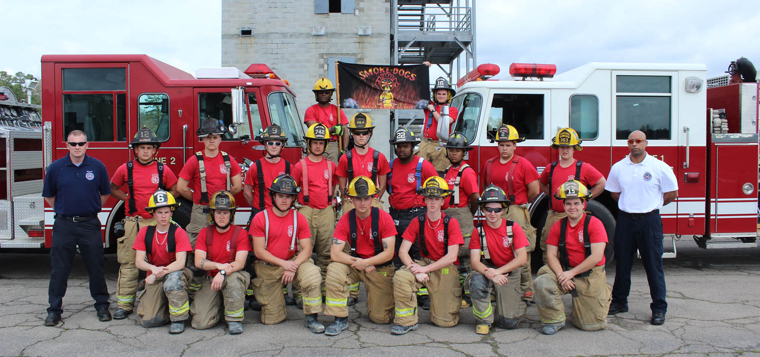 Click to enlarge,  Members of the Central Carolina Community College Fire Academy Spring 2015 are pictured, left to right: first row, Spencer Berube, Adam Hopper, Adam Lowe, John Burnette, Christian Quinlan, Ryan Jollie, and William Bloyd; second row, Captain Cy Richardson, Cody Griffin, Bryan Atkins, Jonathon Scott, Richard Wicker, Camen Mitchell, Tommy Elder, Tramia White, Tyler Flynn, Colton Goodwin, and Lieutenant Tim Houston; third row, Kyles Murphy and Joshua Bullock.
