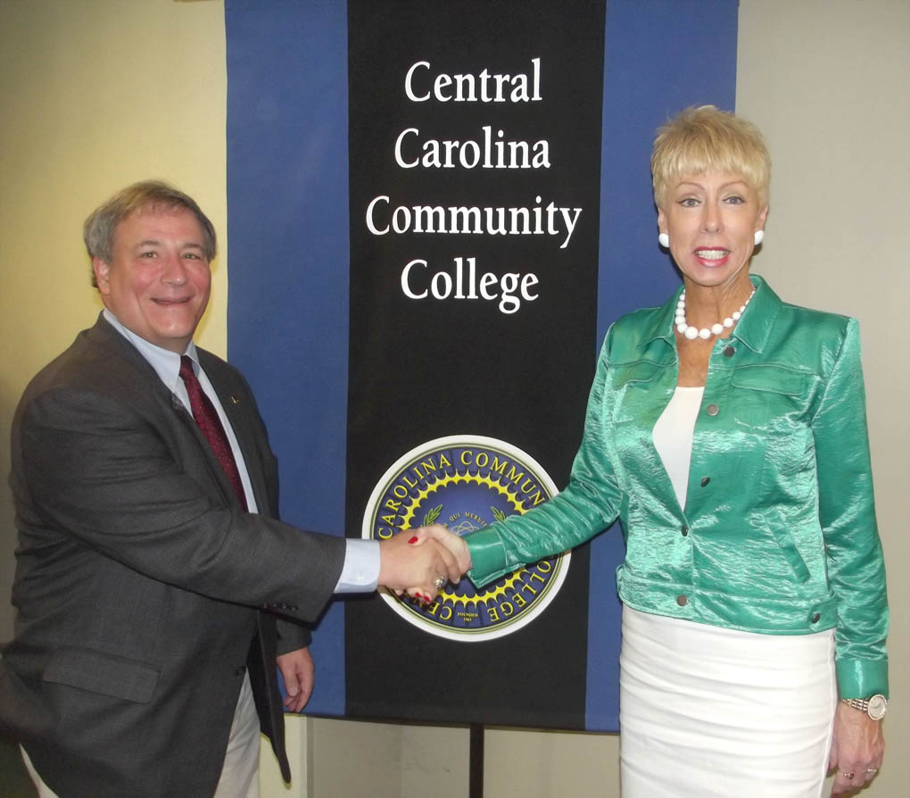 Click to enlarge,  North Carolina State Auditor Beth A. Wood (right) visits with Central Carolina Community College Board of Trustees Chairman Julian Philpott.