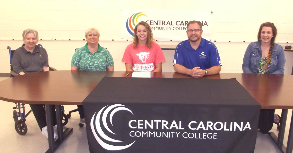 Click to enlarge,  Taylor Wagner (center) has agreed to join the Central Carolina Community College volleyball program. Pictured with Wagner are, left to right: grandmother Donna Johnson, mother Christy Wagner, Taylor Wagner, CCCC volleyball coach Bill Carter, and friend Kendalyn Morgan.