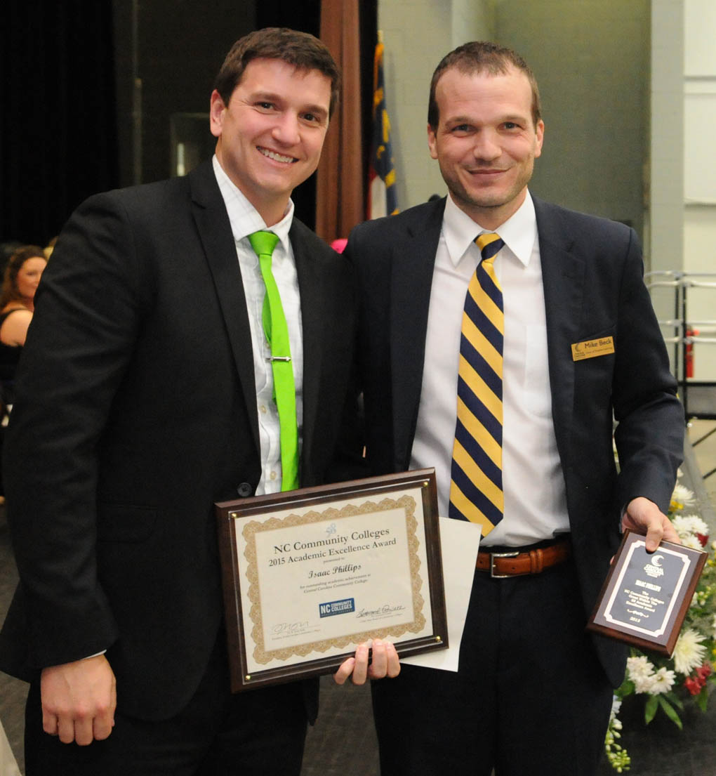 Click to enlarge,  Isaac Phillips  (left) is Central Carolina Community College's winner of the N.C. Community College System's Great Within the 58 Academic Excellence Award winner. Presenting the award to Phillips is Mike Beck, CCCC Dean of Student Learning.