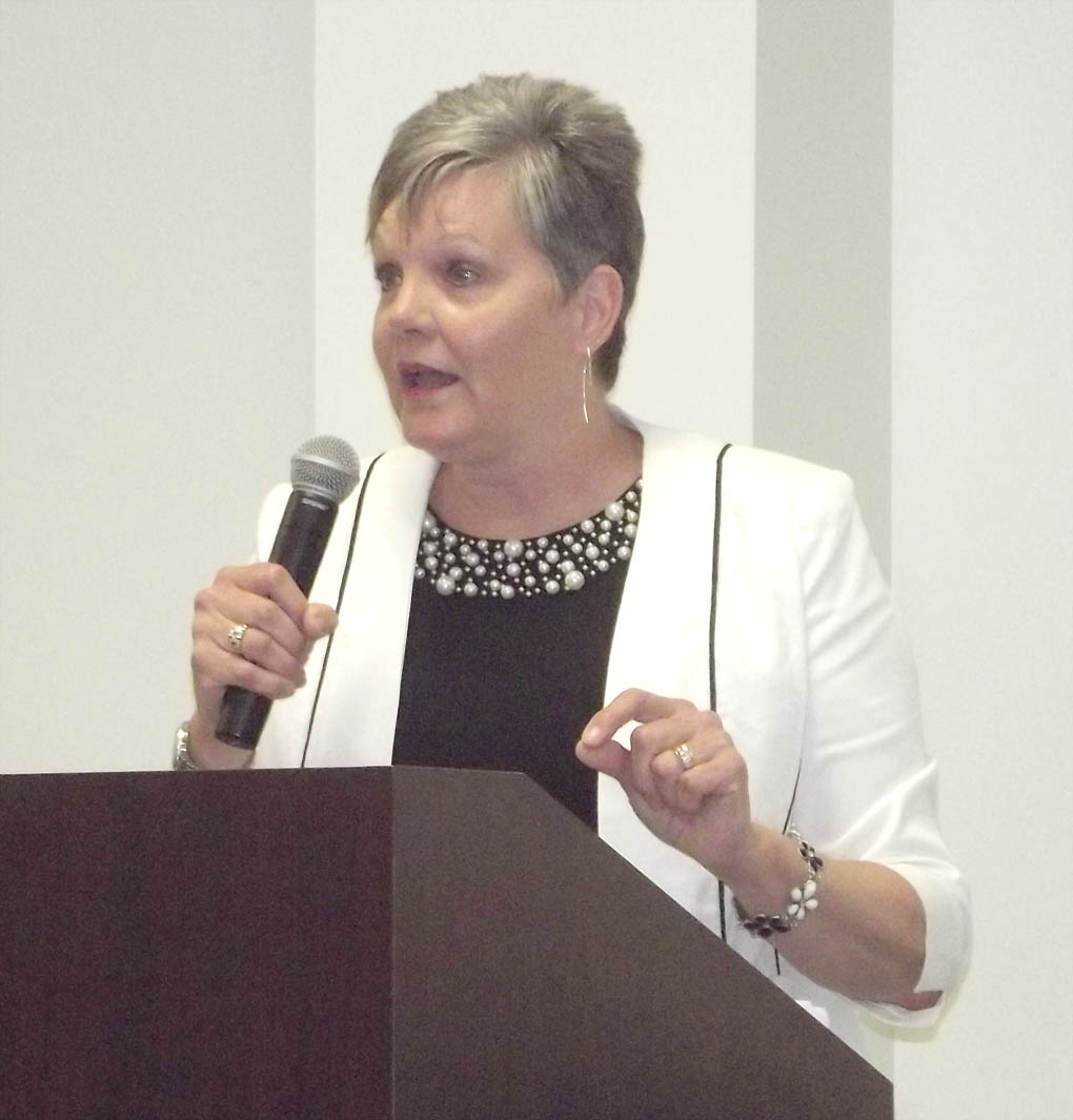 Click to enlarge,  Pamela Howze, Director of Work-Based Learning, N.C. Department of Commerce, speaks at the Caterpillar Youth Apprentice Program graduation and induction.