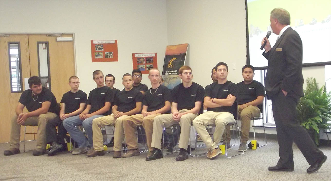 Click to enlarge,  Dr. T.E. Marchant, President of Central Carolina Community College, speaks to the newest graduates of the Caterpillar Youth Apprentice Program.