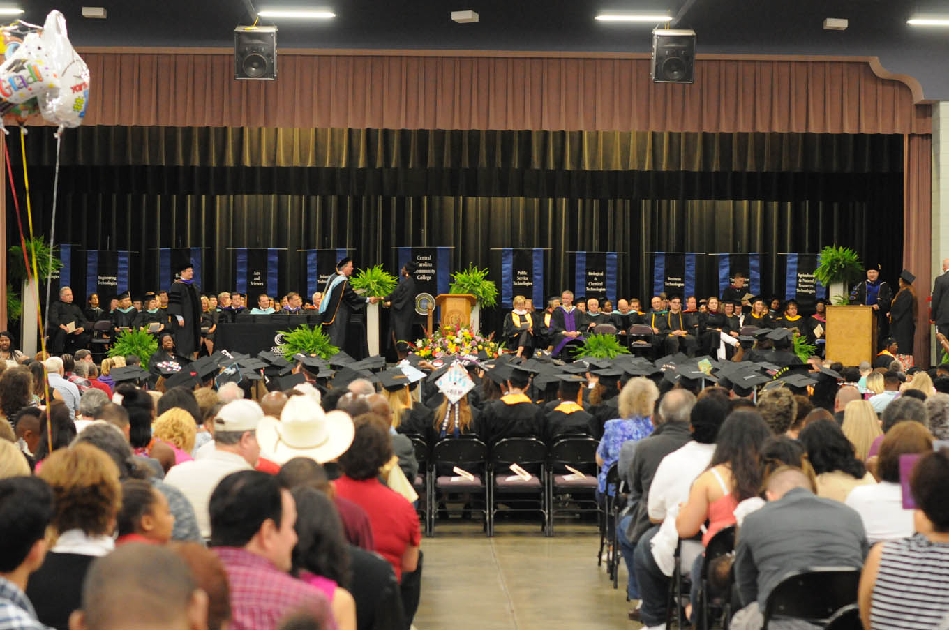 Click to enlarge,  A large audience attended the Central Carolina Community College commencement exercises on May 22 at the Dennis A. Wicker Civic Center in Sanford.