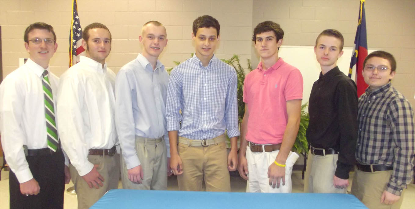 Click to enlarge,  The Central Carolina Apprenticeship Works Computer-Integrated Machining Technology inaugural inductees are, left to right: Billy Gray Sullivan III, Jacob P. Mouton, Tyler A. Walters, Marshall U. Norris, John H. Holly III, Dalton C. Branson, and Jessee L. Hall.
