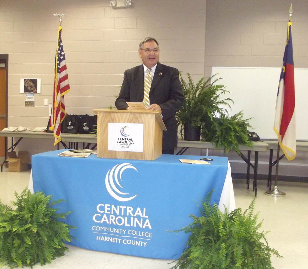 "Click to enlarge,  Jim Burgin, Chairman of the Harnett County Board of Commissioners and a member of the CCCC Board of Trustees, told the inaugural inductees of the new Central Carolina Apprenticeship Works in Computer-Integrated Machining Technology program, ""You guys are going to do great,"" he said. ""I congratulate you and I'm proud of you."""