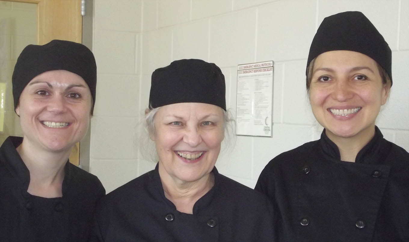 Click to enlarge,  Central Carolina Community College's Summer Natural Chef Certification Program has an international flavor. Three of the class members have foreign ties. Patricia Arbelaez (right) lives in Montreal, Canada. Meriel Goodwin (center) lived in Europe for about 25 years. Audrey Wolff (left), who now lives in North Carolina, is formerly of Paris, France.