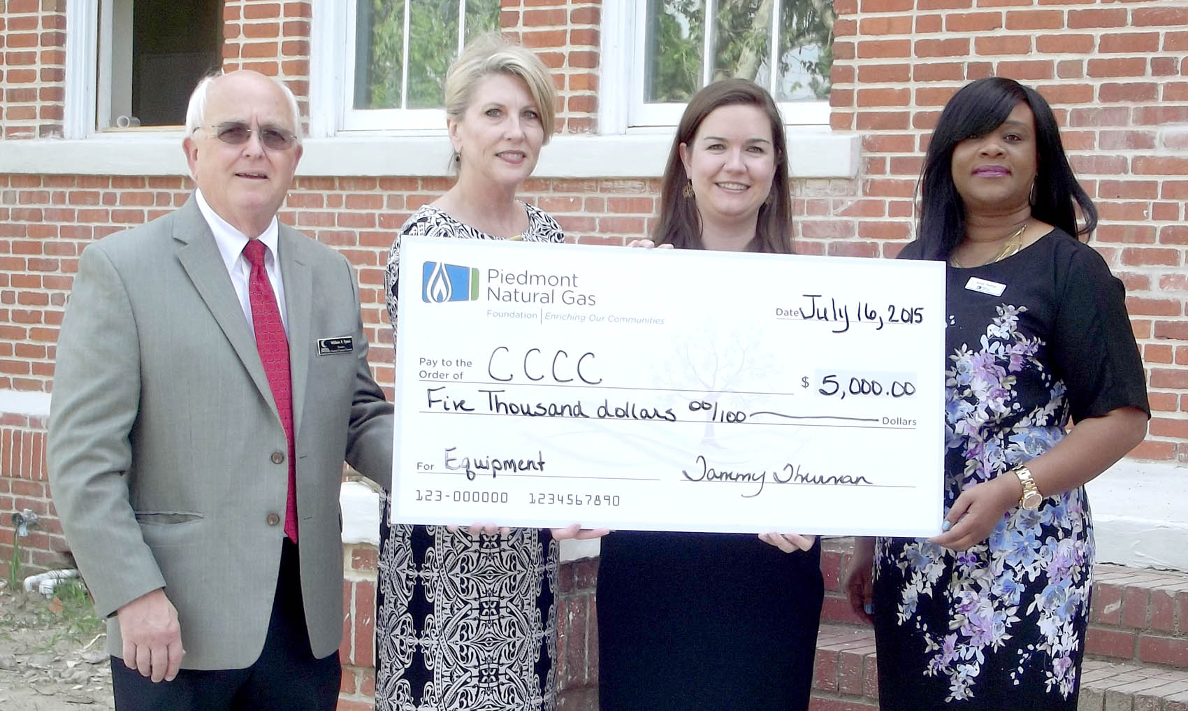Click to enlarge,  The Piedmont Natural Gas Foundation has made a generous $5,000 donation to help equip the kitchen for the Central Carolina Community College's Culinary Arts program at the new Dunn Center. Pictured are (left to right) Bill Tyson, CCCC's Harnett County Provost; Rebecca Howington, CCCC Dunn Center Site Coordinator; Emily Hare, CCCC Foundation Executive Director; and Tammy Thurman, Piedmont Natural Gas Community Relations Manager (NC-East).