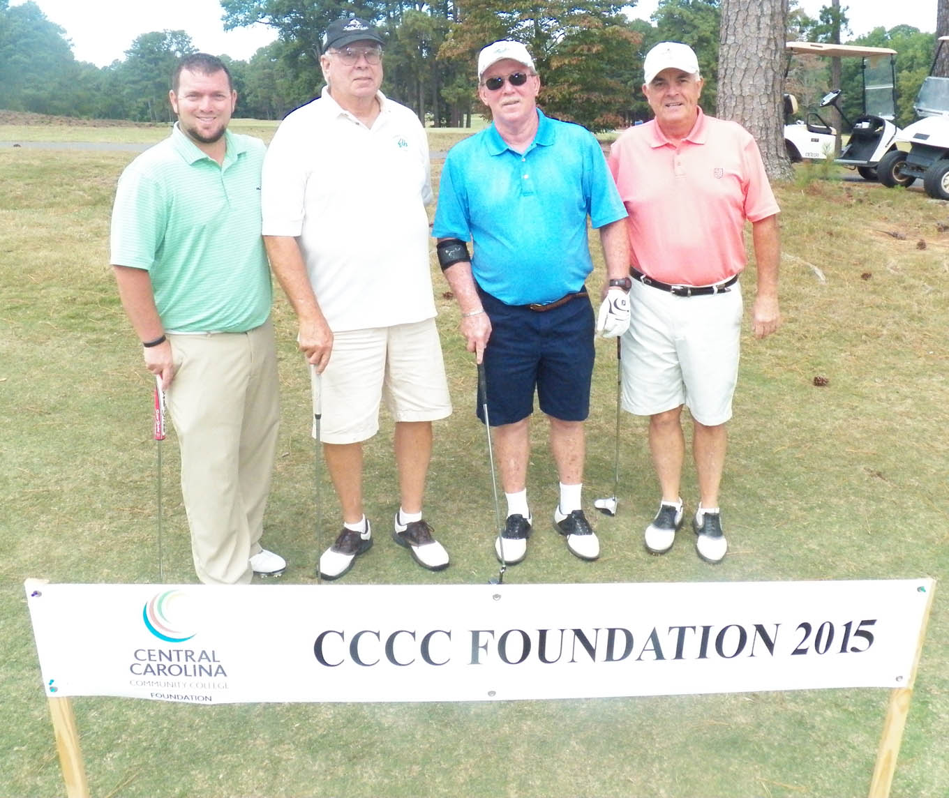 Click to enlarge,  The team of Brandon Honeycutt, Tom Gordon, Roy Eubanks, and Mike Large won the first flight of the afternoon tournament of the CCCC Foundation Lee Golf Classic.